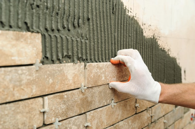 installing-tiles-wall_191163-1298
