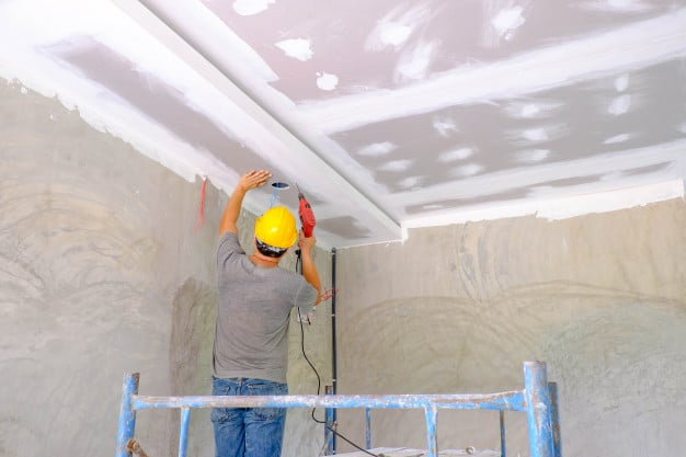 worker-installing-board-ceiling_51137-180