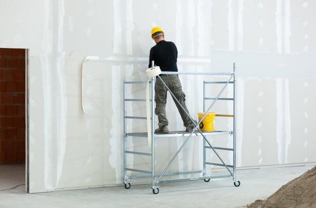 worker-plastering-gypsum-board-wall_87414-3765
